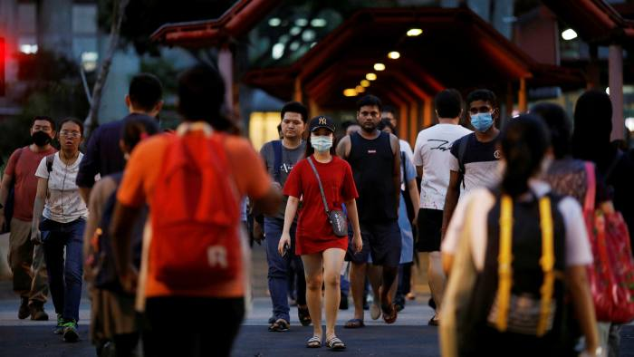 Photo of Singapore reports record new cases, quarantines 20,000 migrant workers